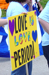 love is love sign at pride parade